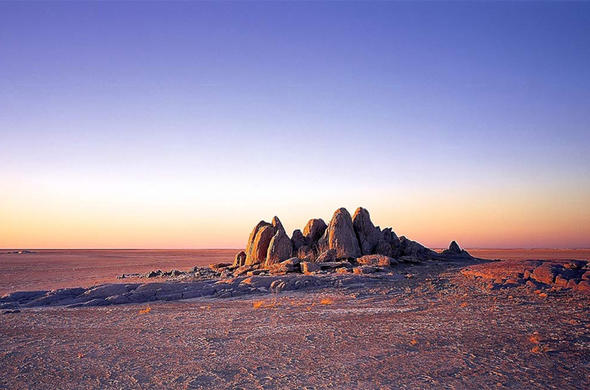 Makgadikgadi. Rocky outcrop. The highest point for miles.