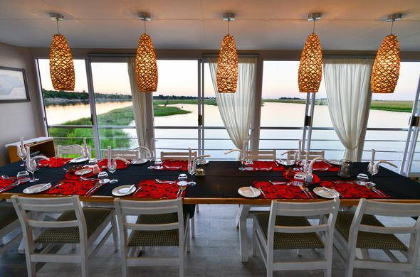 Dinning area on board your Chobe River houseboat.
