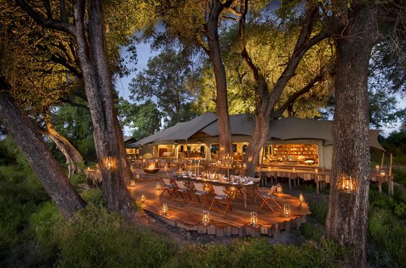 Enjoy dinner under the starry skies at Duba Plains Camp.