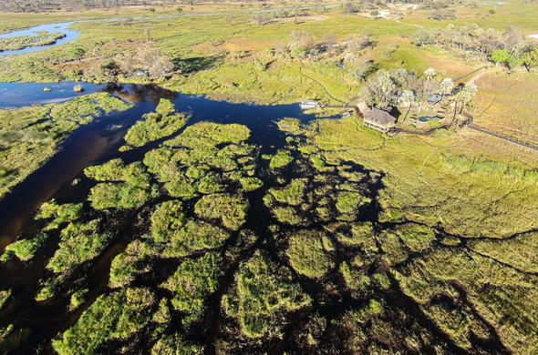 Aerial view of Gunns Camp located in the Okavango Delta.