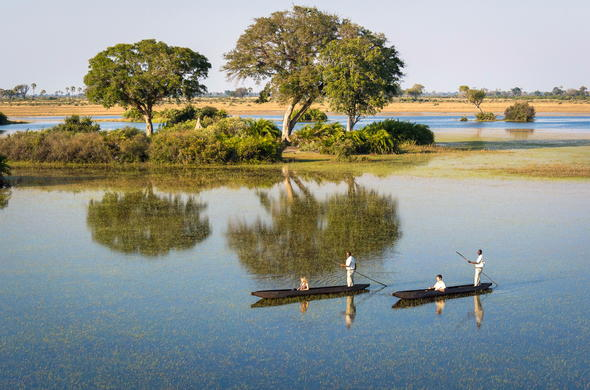Traditional mokoro canoe trip through the Okavango Delta.