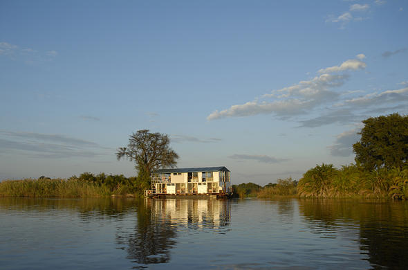 Kabbo House-Boat moored for sunset on Okavango River