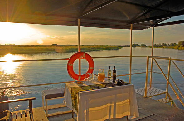 Sundowners on the Okavango Panhandle aboard the Kabbo house-boat
