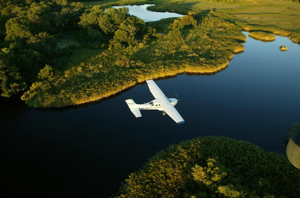 Flying over the Okavango Delta in a light aircraft.