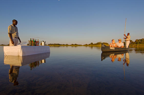 Mokoro and sundowners at Camp Okavango