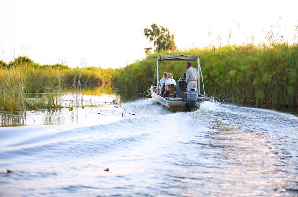 Motorboat safari through the Okavango Delta lagoons and channels.
