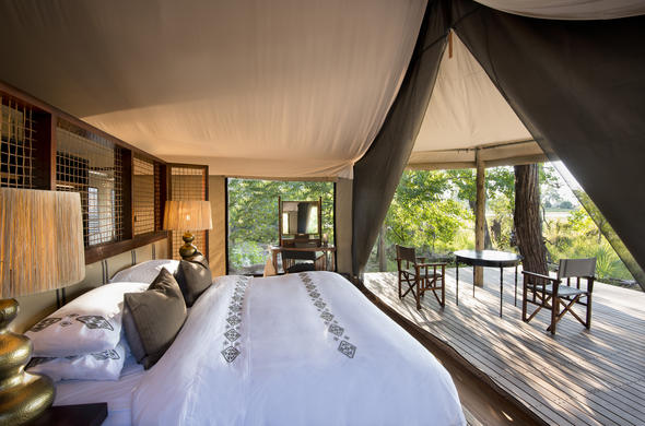 Comfortable room with private patio at Nxabega Okavango Tented Camp.