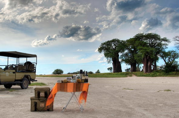 Stop for sundowners during a game drive.
