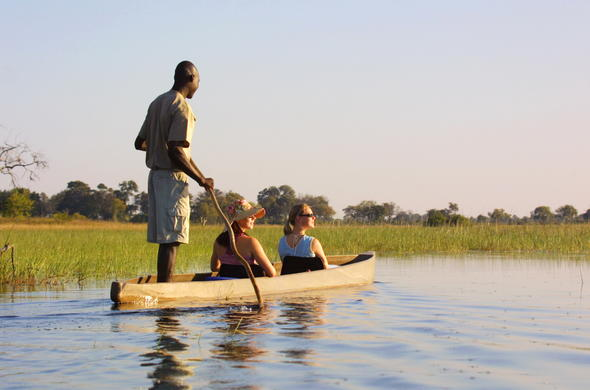 Looking for Botswana wildlife from a mokoro dugout canoe.