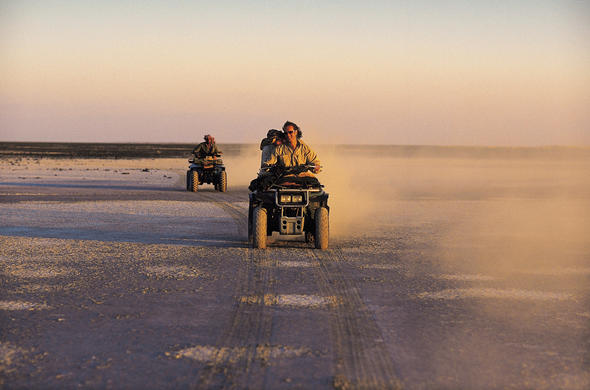 Tak a quad bike across Makgadikgadi at sunset from Jack's Camp