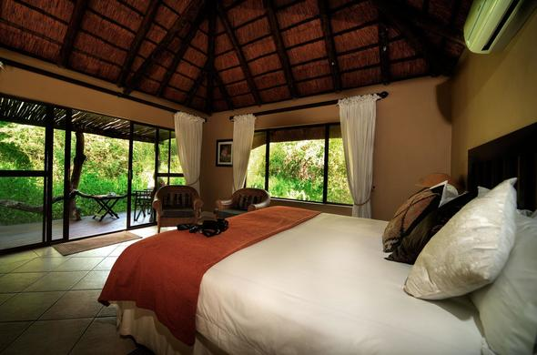 Comfortable thatched roof accommodation at Royal Tree Lodge.