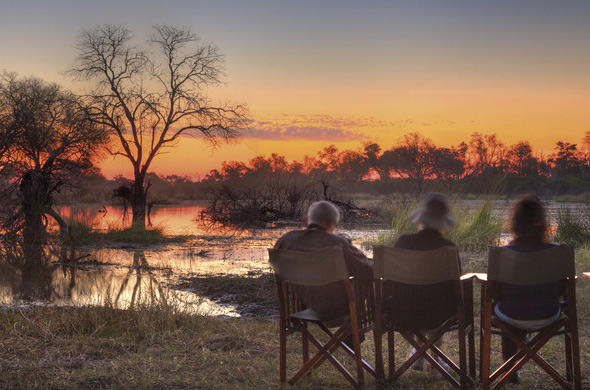 Sun-downers at waters edge at Savute Elephant Camp
